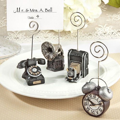 25 Vintage Place Card Holder Phone Camera Wedding Favors Shower Event Bulk Lot  Perfect for the Gatsby Wedding theme - old fashioned camera, telephone, alarm clock and phonograph - nostalgia at it's best!  Use as place card holders or food buffet markers.  http://cgi.ebay.com/ws/eBayISAPI.dll?ViewItem&item=360824048423  Only $57.99 for a bulk lot of 25 assorted.  Free shipping within the continental US.