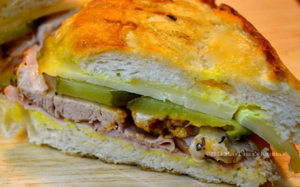 Cuban-Style panini sandwich after cooking and sliced to show pork ...