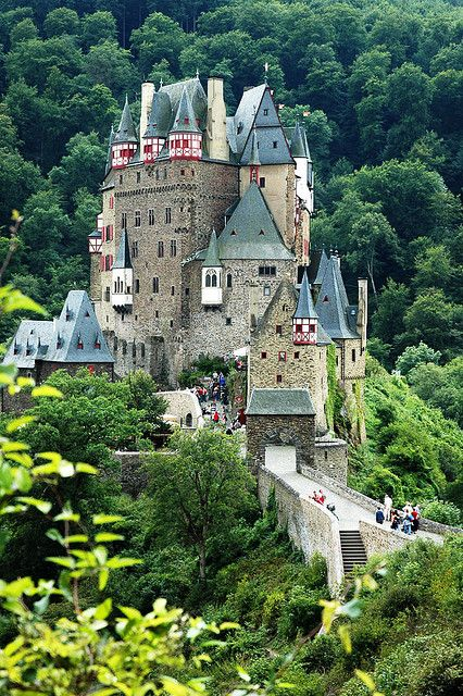 Burg Eltz is a medieval castle on Germany's 'Castle Road', and is still owned by a branch of the family who lived there 33 generations ago, in the 12th century.    It sits on a huge rock at the center of a wooded but otherwise empty small valley, high above the Moselle River between Koblenz and Trier, and unlike most German castles has never been destroyed and had to be rebuilt.