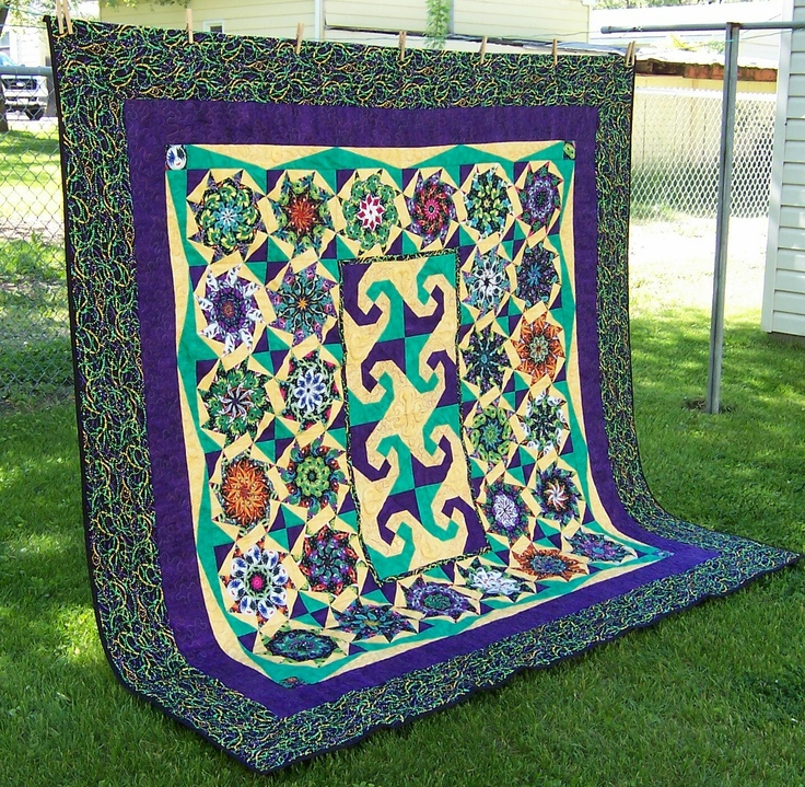Mindy's Mardi Gras queen size quilt, made by me, Cindy Garcia.  An original design.
