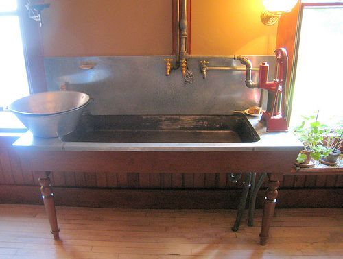 vintage farmhouse sink with wooden legs