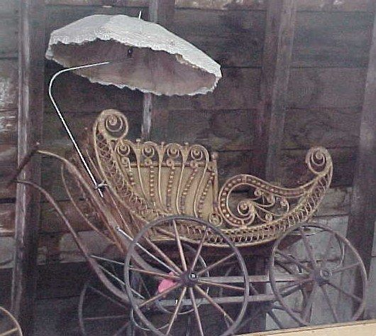 Victorian fancy wicker carriage with parasol circa 1885