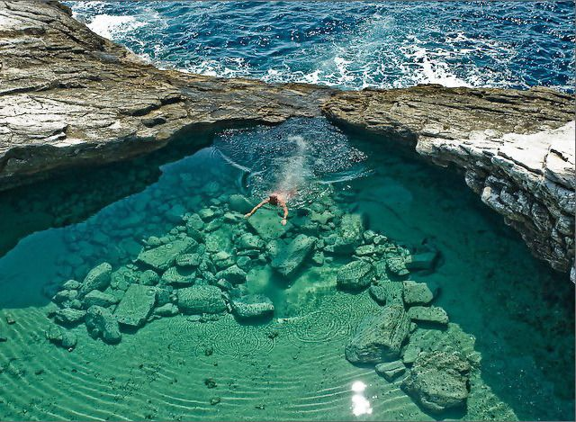 Giola Lagoon, carved out of stone by the ocean - on the Island of Thassos, Greece