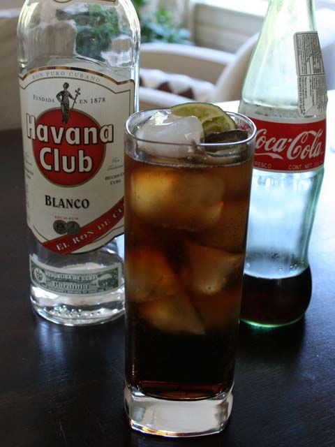 Cuba Libre 2 ounces rum Coca-Cola Lime Pour two ounces of rum (Cuban ...