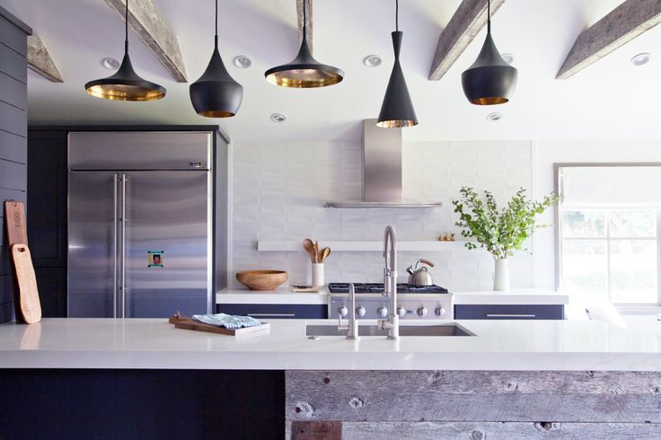 You'll Envy This Effortlessly Cool Family Home // black and gold pendant lights, white kitchen island, wood rafters