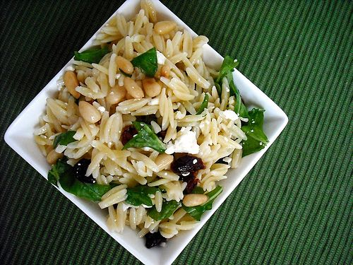 Orzo, arugula, pine nuts, feta cheese, cranberries and lemon juice :-)