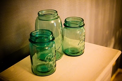 Beautiful blue mason jar composition in a bedroom!