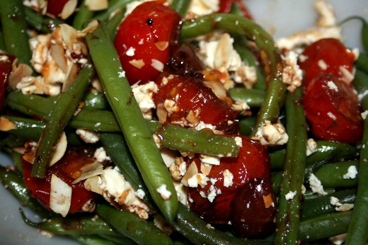 Steamed green beans and balsamic roast tomato and olive salad with ...