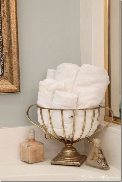 Decorating Bathroom Baskets Towels : Rolled up towels in a metal basket bathroom ideas