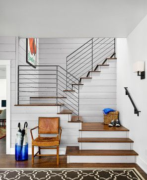 entry with modern steel stair railing // Clayton & Little Architects