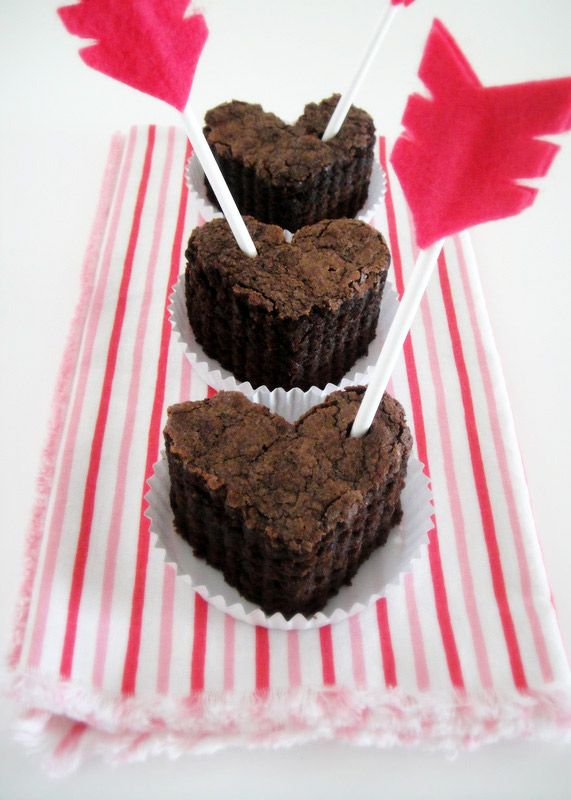 Valentines Day brownies...use bamboo skewers sideways...maybe add a little raspberry or strawberry filling or topping...