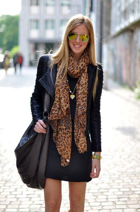 Street style  Short skirt, classic black jacket, slouchy soft hobo, and the classic Louis Vuitton Stephen Sprouse leopard scarf