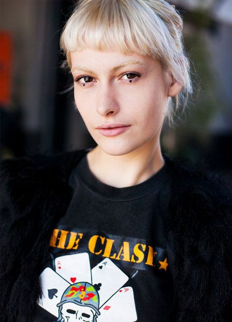 A dab of black eyeliner under the eyes paired with bleached brows and a Clash tee. Bold and beautiful.