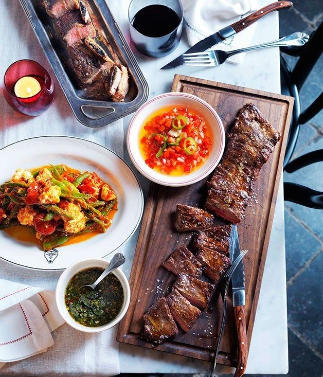 Char-grilled skirt steak and beef short ribs with salsa criolla and ...