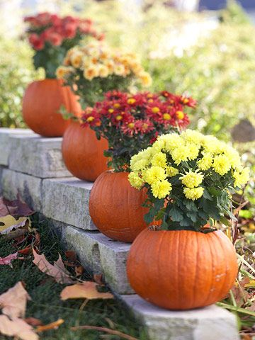 Put fall flowers in hollowed-out pumpkins for easy outdoor decor. See more outdoor decorating ideas: http://www.bhg.com/halloween/outdoor-decorations/fall-outdoor-decorating-from-halloween-to-thanksgiving/?socsrc=bhgpin100212pumpkinplantholders#page=3