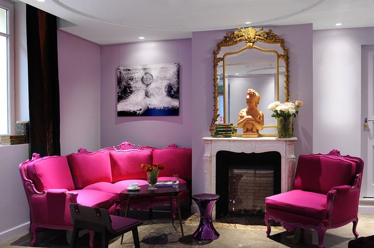 living room: historic modern, lavender walls, magenta furniture.