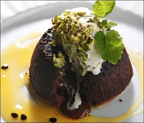 Hot chocolate cake with vanilla ice cream, passion fruit sauce and ...