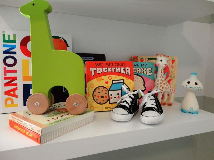 Nursery shelf styling for a modern nursery