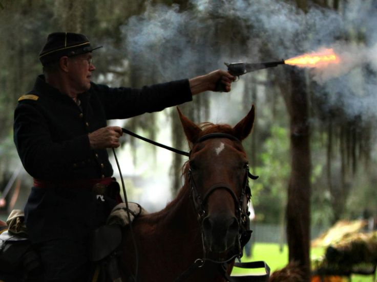 at Confederate troops during the Battle of Gainesville reenactment