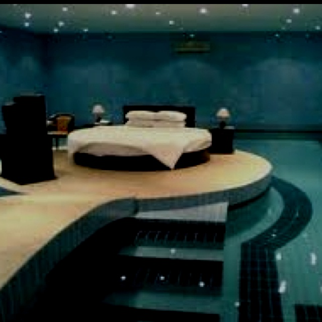 Coolest bedroom ever surrounded with a swimming pool for Cool bedrooms