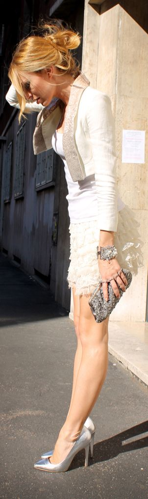 White dress with silver purse and high heel shoes