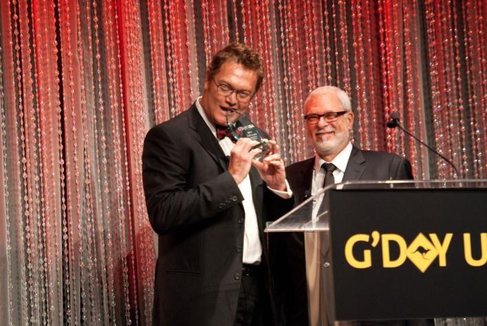 Phil Jackson presents to Luc Longley at 2012 LA Black Tie Gala