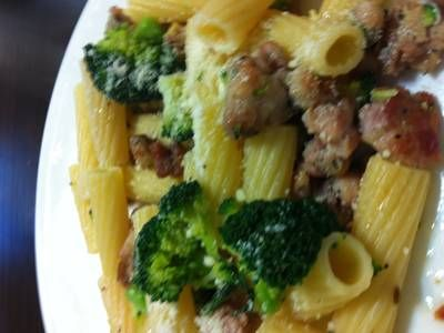 Rigatoni together with broccoli and sausage and a garlic, oil and ...