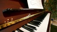 How to Clean a Black Lacquer Baby Grand Piano