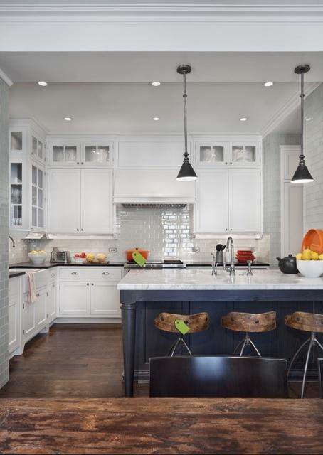 Dark gray island White cabinets in background