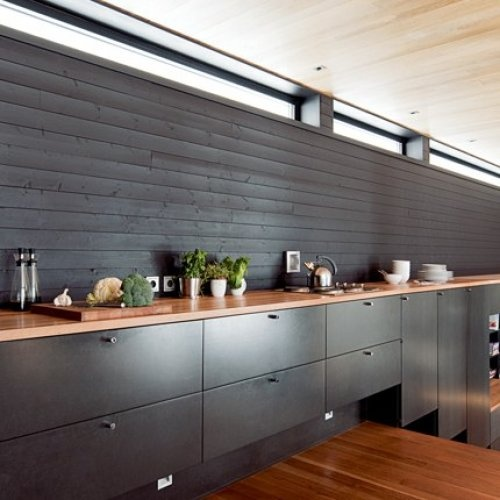 Black stained wood walls and cabinets, lighter wood counter top and