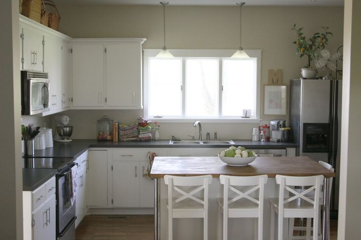 White kitchen, dark gray counter tops, large island, little lemon