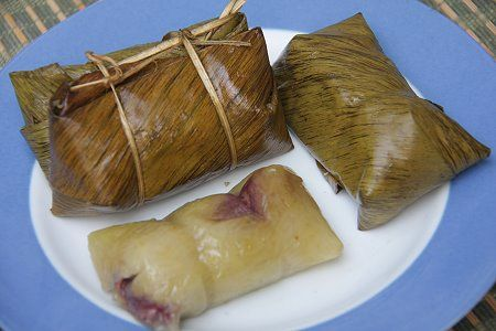 Looks like the traditional Mexican tamales in banana leaves, except it ...