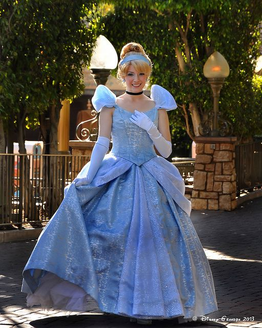Princess Cinderella in front of it's a small world!