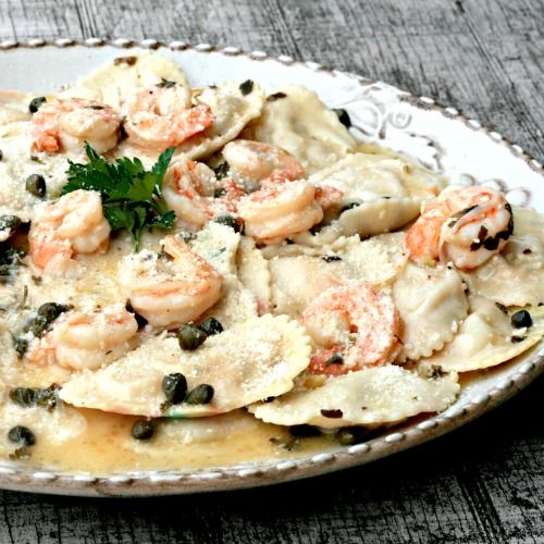 lobster ravioli with shrimp and garlic caper cream sauce.