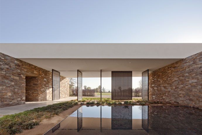 Water court inside the Desert Panorama House by XTen Architecture.