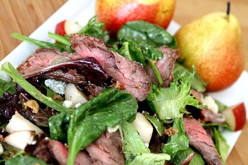 skirt steak salad with crispy onions comice pears and blue cheese
