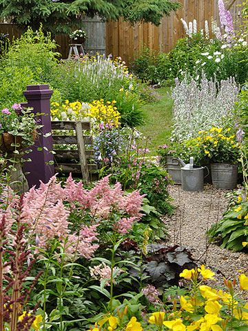 By using the same plant or plants with a similar feel, you can draw the eye through your borders. Here, for example, she's combined upright, light-color plants, including pink astilbe, lamb's ears, white veronica, and white delphiniums, to lead the way to her cozy bench.