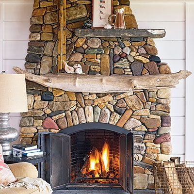 gorgeous fireplace made from river rocks
