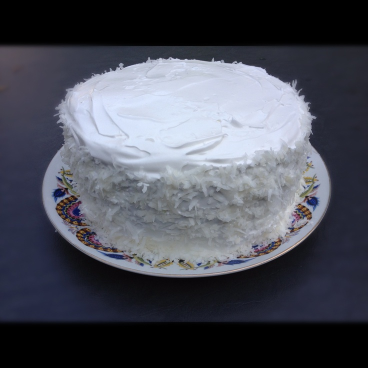 layer coconut cake, whipped chocolate ganache filling, and coconut rum ...