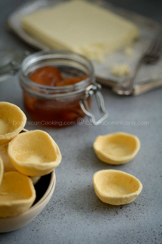 Mini-tart shells filled with ricotta and fruit in spiced syrup