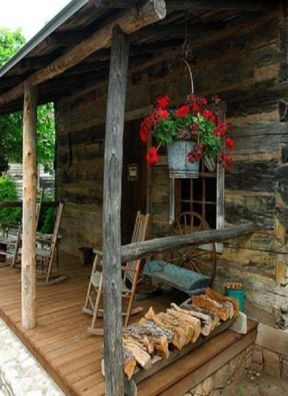 cabin porch with wood piled by rail the porch pinterest
