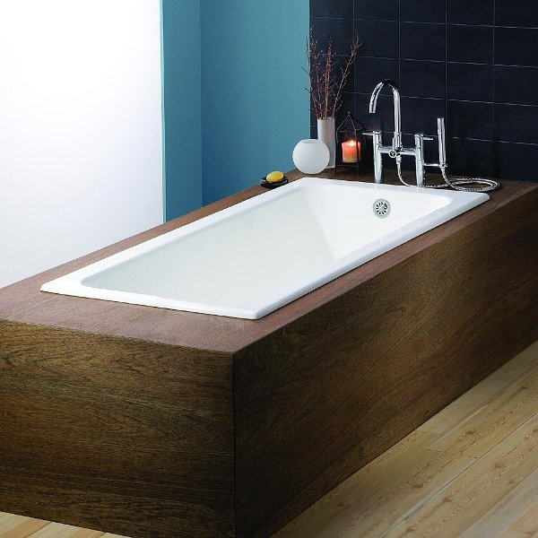 Drop in bathtub dropped into wood surround