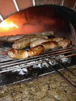 Grilled Italian sausage in the wood-fired oven.