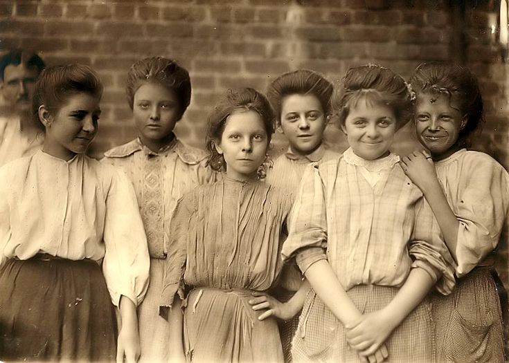 Don't they look mischievous! This photograph shows a group of young girls that work in a cotton mill. The picture was taken in about 1909 in Georgia. Work in a cotton mill would have amounted to little more than a sweatshop at this time. It is amazing how several of these girls manage a smile for the camera.