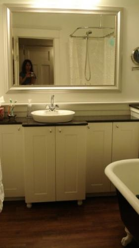 bathroom vanity made from akurum wall cabs to maximize space in this