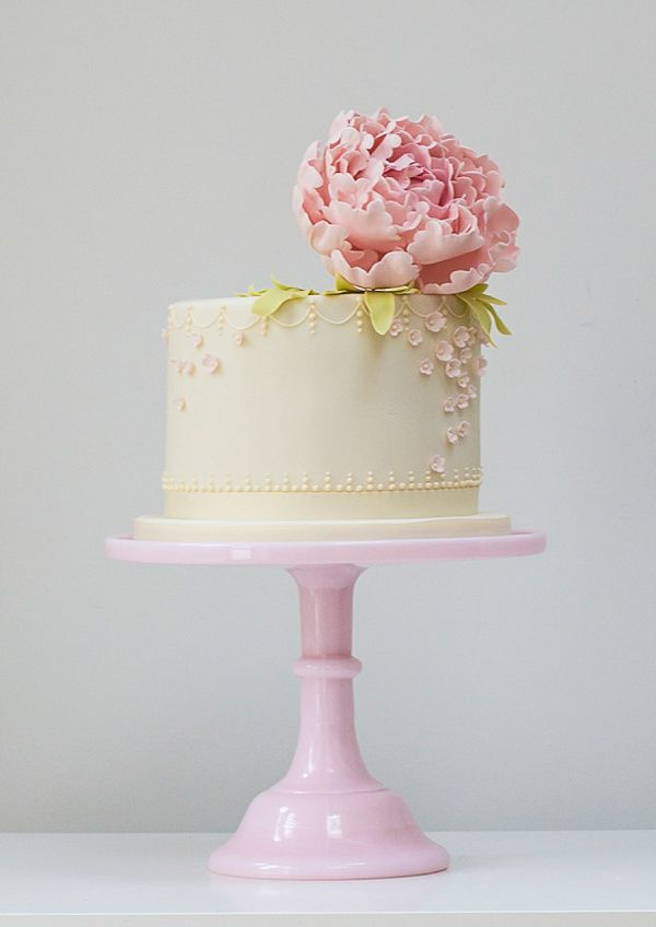 Pretty single tier wedding cake on a pink vintage style cake stand with a floral topping by Rosalind Miller Cakes ~ Beautifully Decorated and Delicious Award Winning Wedding Cakes  http://www.rosalindmillercakes.com/