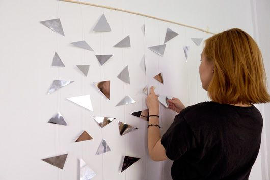 DIY Geometric Mirror Photo Backdrop // this tutorial is fairly simple ...