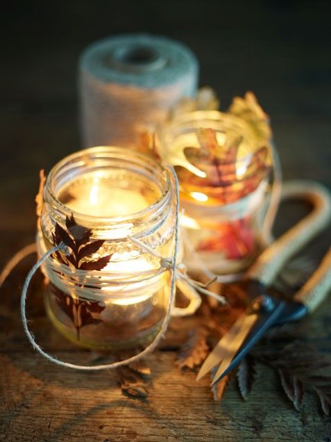 Votive candles in jars wrapped with twine and leaves ~~