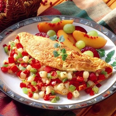 Western Omelet Fluffy omelet packed with bell pepper, potato, bacon ...