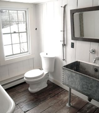 This rustic sink is a perfect fit for this snowy mountain chalet!